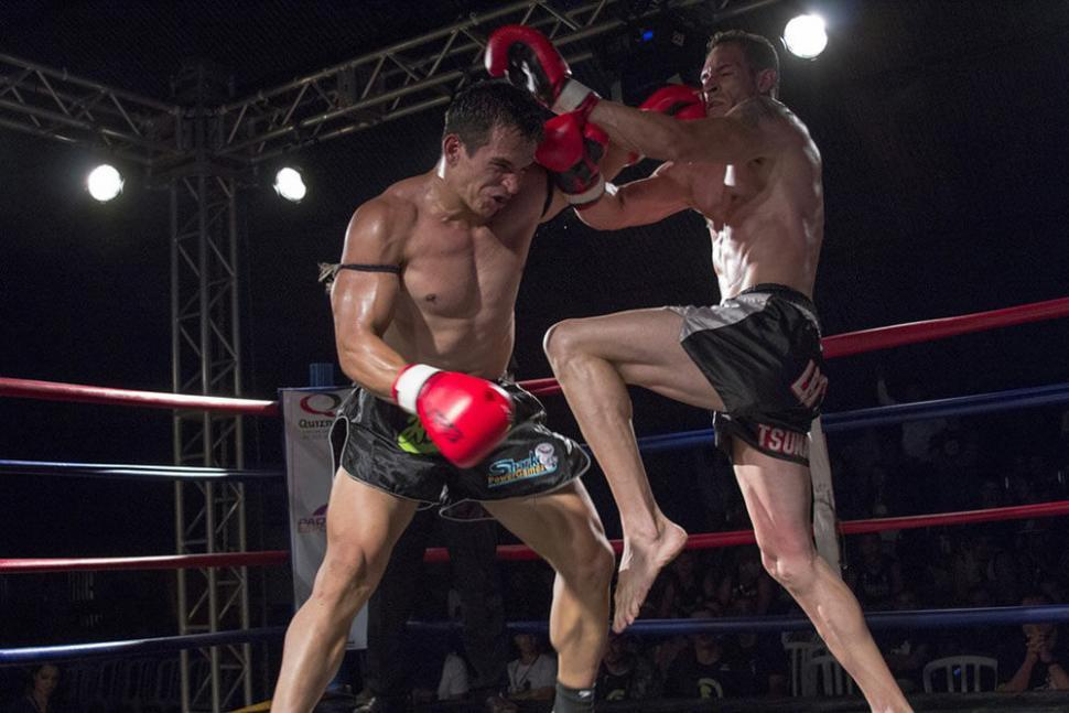 Two Muay Thai Fighters In The Ring Fighting.