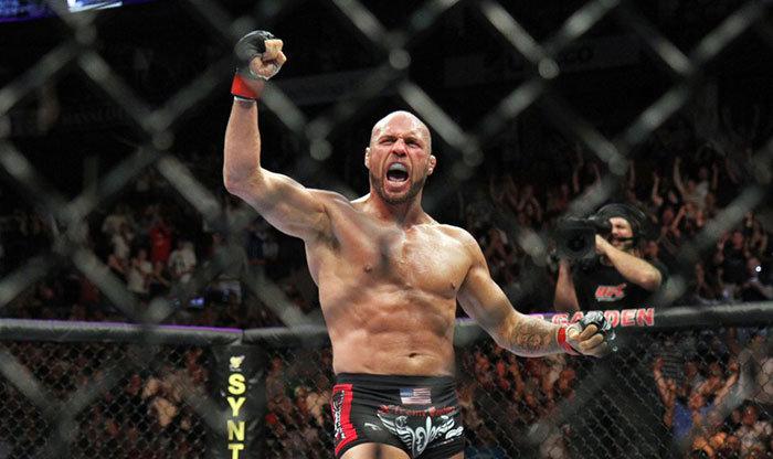 Randy Couture celebrates win against boxer James Toney.