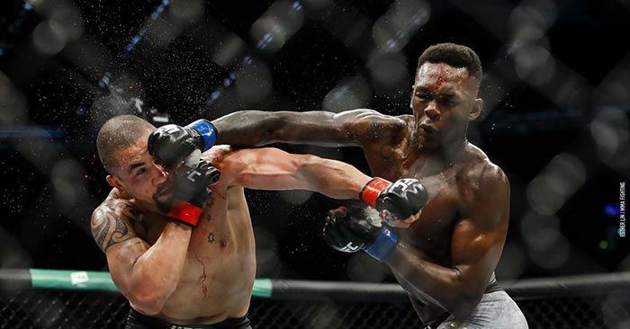 Israel Adesanya Lands A Right Hand On Robert Whittaker At Ufc 243 In Melbourne
