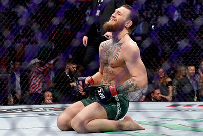 Conor Mcgregor On His Knees Celebrating His Win At Ufc 246.