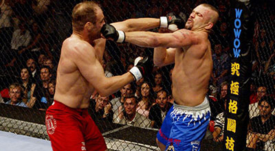 Chuck Liddell and Randy Couture exchanging blows at UFC 57