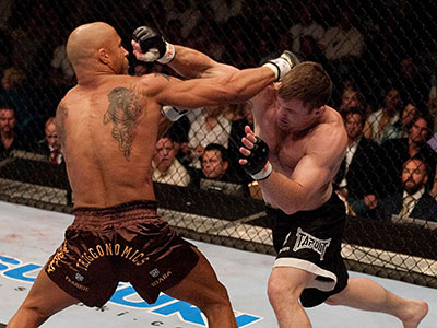 UFC champion Matt Hughes and Frank Trigg miss with punches UFC 52.