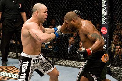 Quinton Rampage Jackson swings a left hook at Wanderlei Silva UFC 92