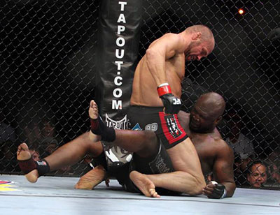 Randy Couture mounts James Toney in their UFC 118 fight.