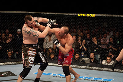 Tim Sylvia being punched Randy Couture at UFC 68.