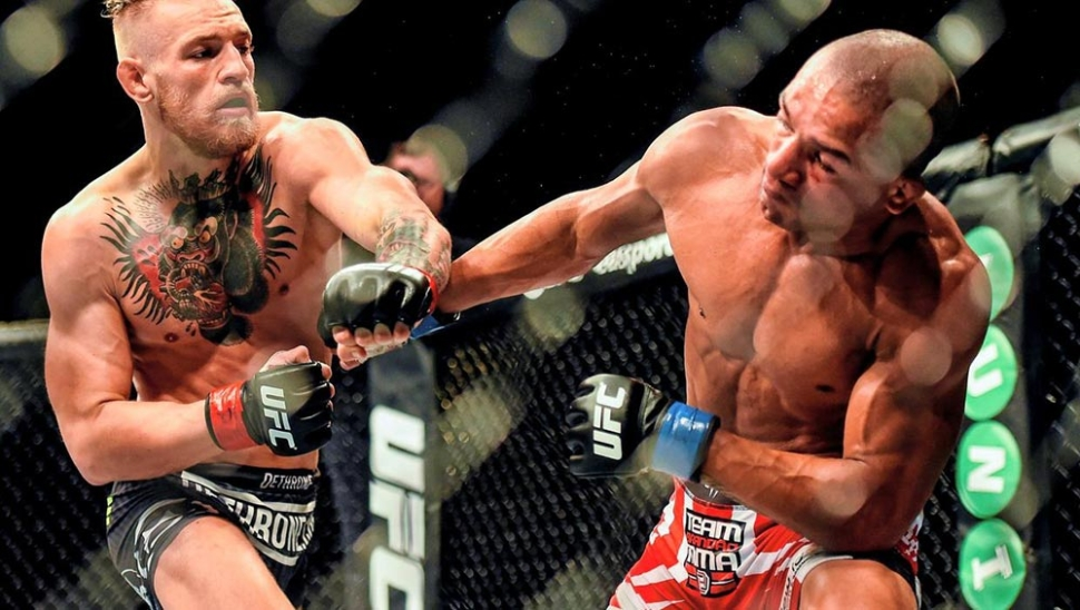 Conor Mcgregor Land A Right Hand On Diego Brandao At Ufc Dublin.