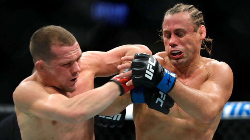 Petr Yan Lands Elbow On Urijah Faber During Their Fight.