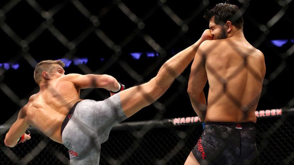 Stephen Thompson lands a head kick on Jorge Masvidal UFC 217.