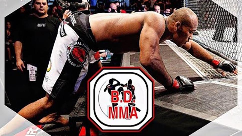 Brazilian fighter Jacare Souza climbs into the UFC octagon.
