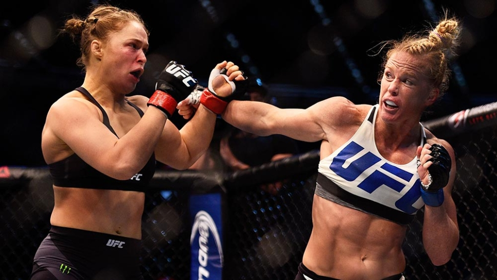 Ronda Rousey vs Holly holm lands a punch at UFC 193 Melbourne.