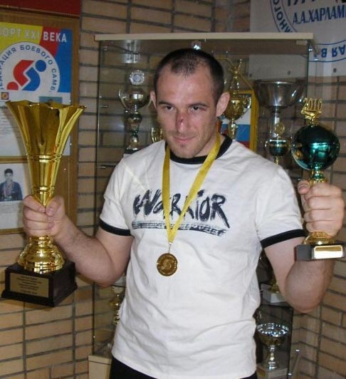 ALEKSEI OLEINIK with trophies