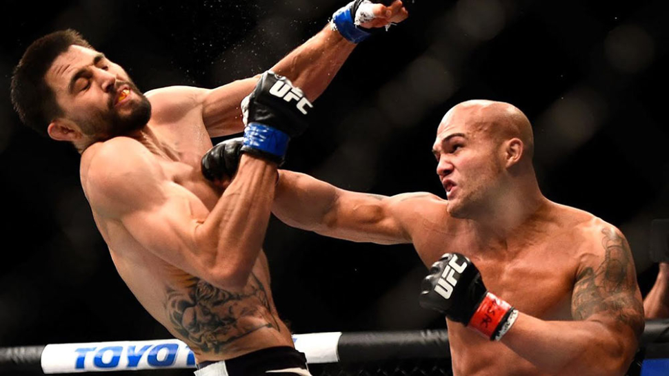Champion Robbie Lawler and Carlos Condit exchange at UFC 195.
