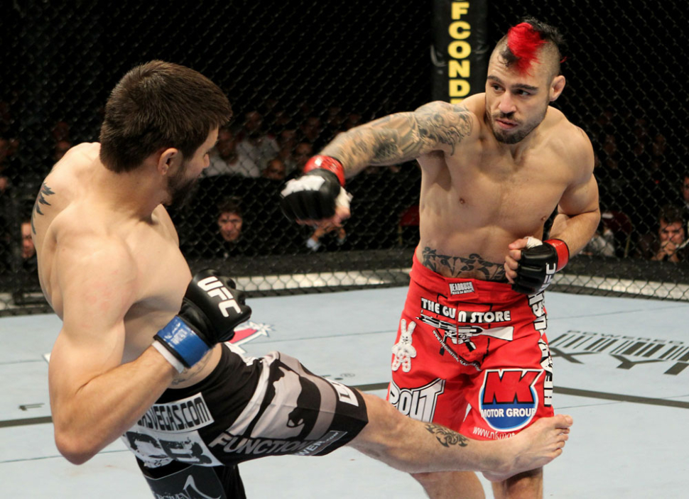 Carlos Condit And Dan Hardy Fighting In The Ufc.